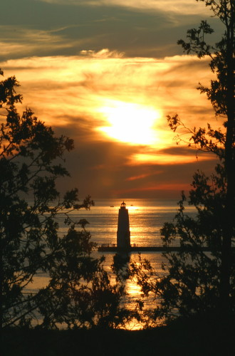 D-LH-148 - Sunset over Lake Michigan and the Harbor Lighthouse. Frankfort, MI.