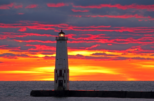 D-LH-573 - Sunset over Lake Michigan and the Harbor Lighthouse. Frankfort, MI.