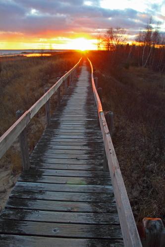 D-RP-196 - Boardwalk along the shore of Lake Huron, at Sunset. Tawas State Park. Tawas City, MI.